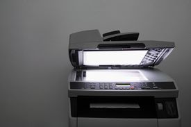 Lit up photocopier with open lid