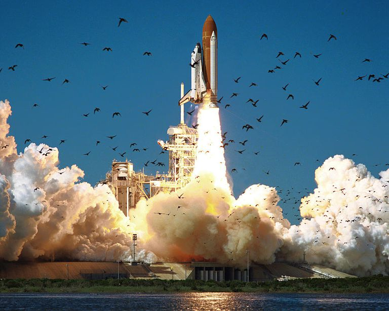 A picture of the Space Shuttle Challenger lifting off at the Kennedy Space Center.