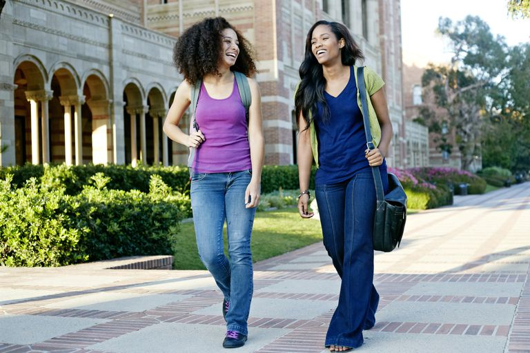 Two college students walking together on campus