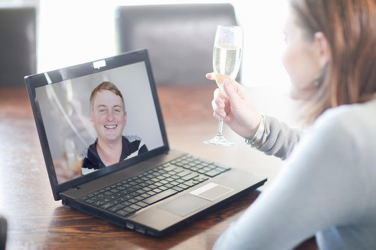 Woman toasting husband using video call