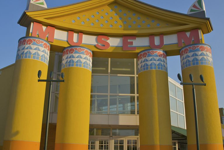Colorful over-sized columns and pediment with word Museum