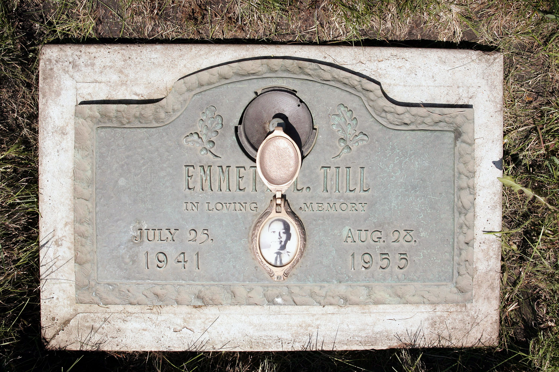 A plaque marks the gravesite of Emmett Till at Burr Oak Cemetery in Aslip, Illinois.