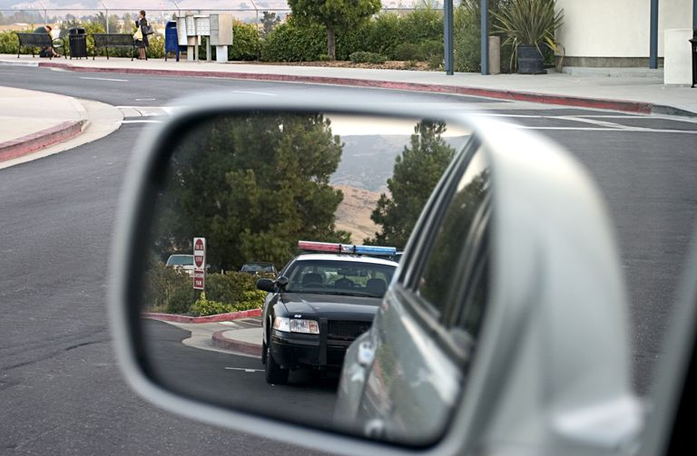 A police car in a side mirror