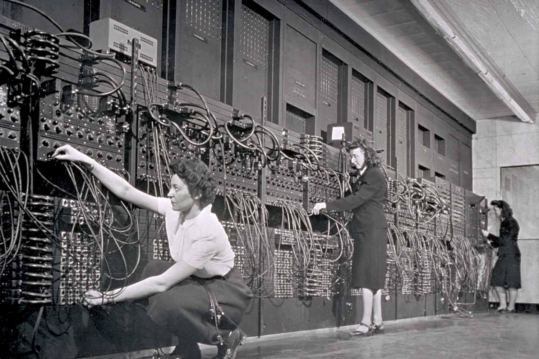 Computer operators program ENIAC, the first electronic digital computer