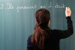 Teacher writing French