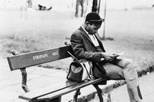 Man Sitting on 'Europeans Only' Bench