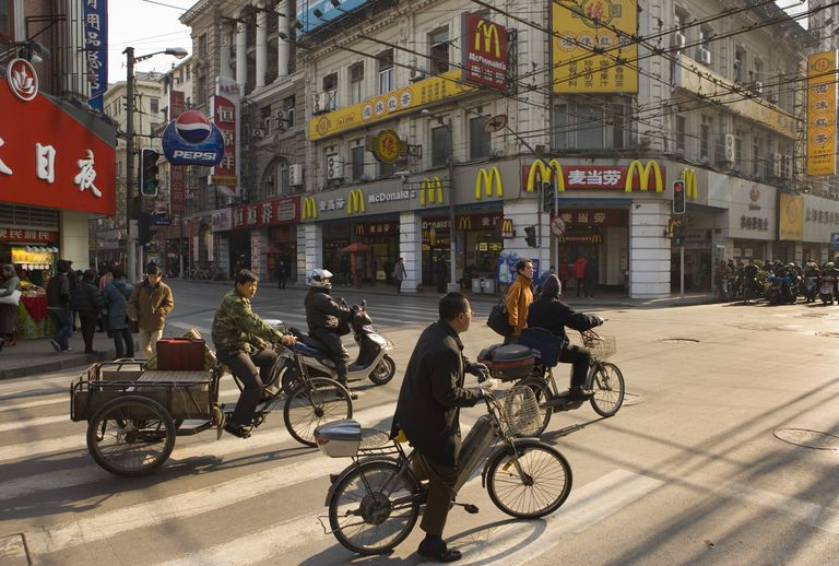 Symbolizes of capitalism in China, including McDonald's and Pepsi, show convergence theory in action.