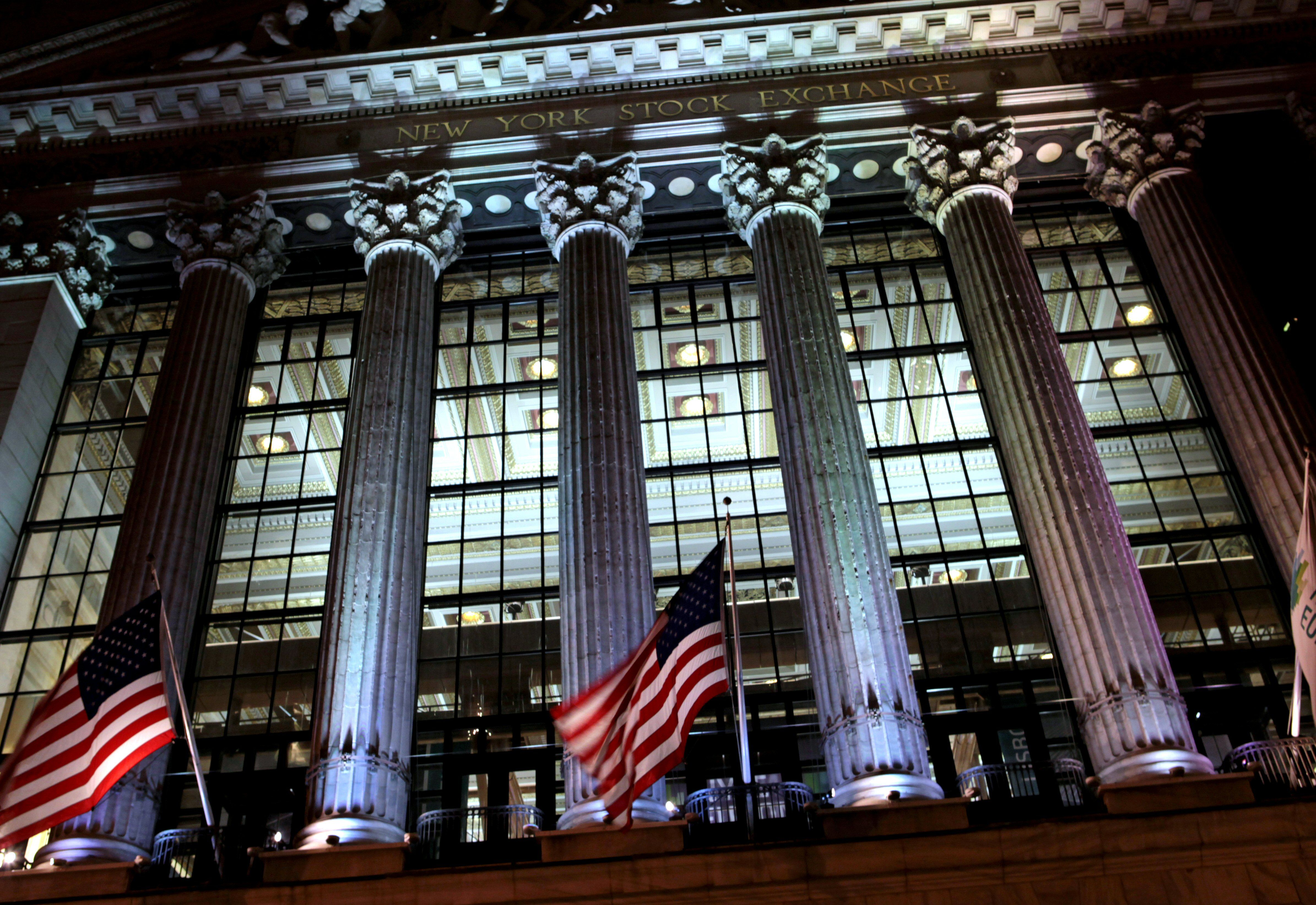 Night view looking through glass curtain wall facade of New York Stock Exchange (NYSE), designed by George B. Post