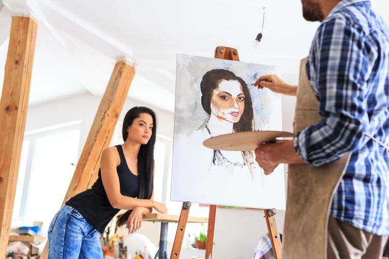 Artist making portrait of young woman