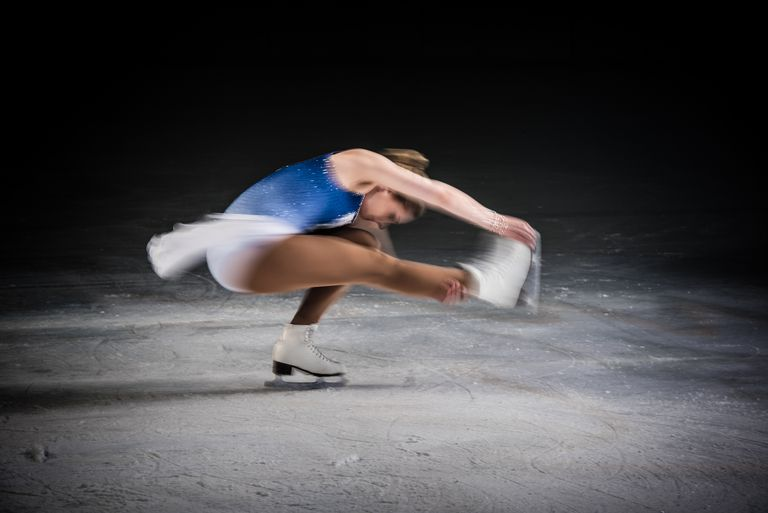 A figure skater turns on one foot