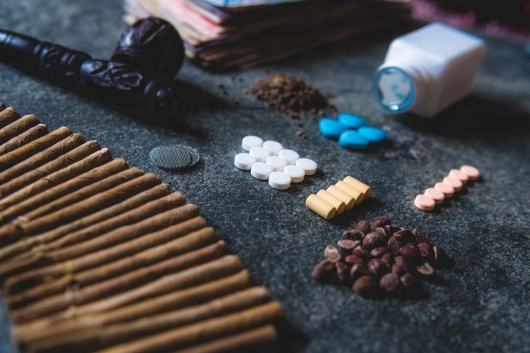 Close-Up Of Various Medicines And Weed On Table
