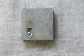 comma punctuation on wooden block