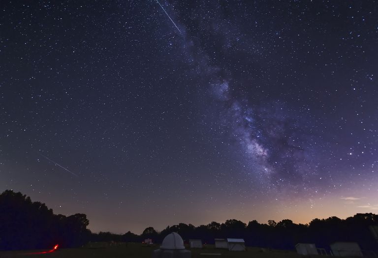 Two Perseid meteors streak across the Milky Way during the 2012 meteor shower in Oklahoma.