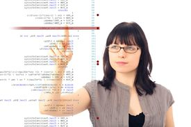 Woman-coding-nullplus-E-Plus-Getty-Images-154967519.jpg