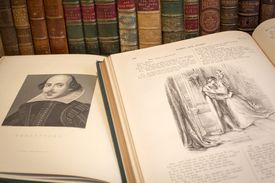Romeo and Juliet books open to an illustration of Shakespeare and the lovers