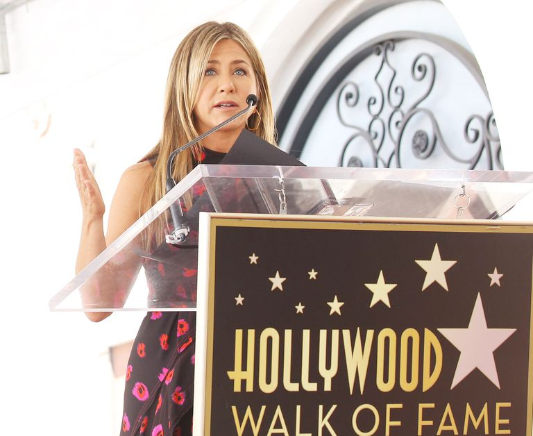 Jennifer Aniston speaking at a Hollywood Walk of Fame event.