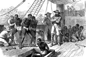 Enslaved people being chained by enslavers aboard a ship and forced below deck