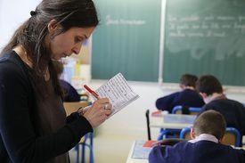 Teacher taking notes