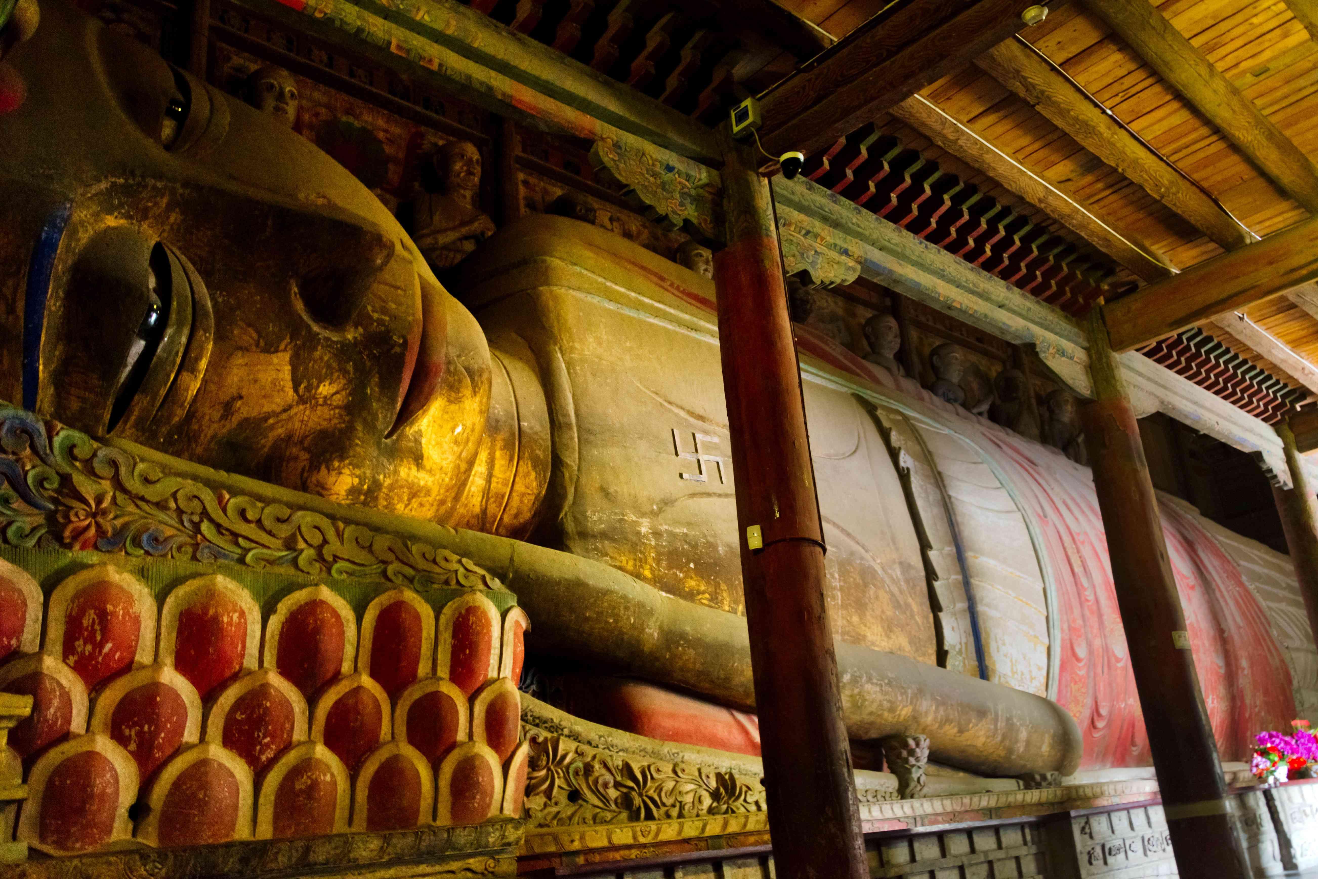 The 35-meter long reclining Buddha statue in Gansu