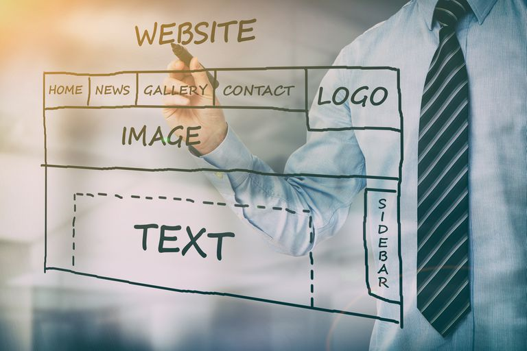 Designer sketching a design of a website with a sidebar
