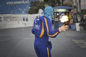 A Molotov cocktail is a fuel-filled bottle with a fuse.