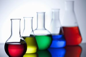 Flasks and beakers holding a variety of chemicals.