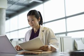 Medical professional using laptop