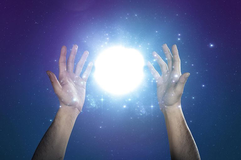 hands reaching for angel orb mystery light