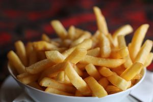 Bowl of French fries close up.