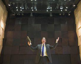 preacher giving sermon on stage