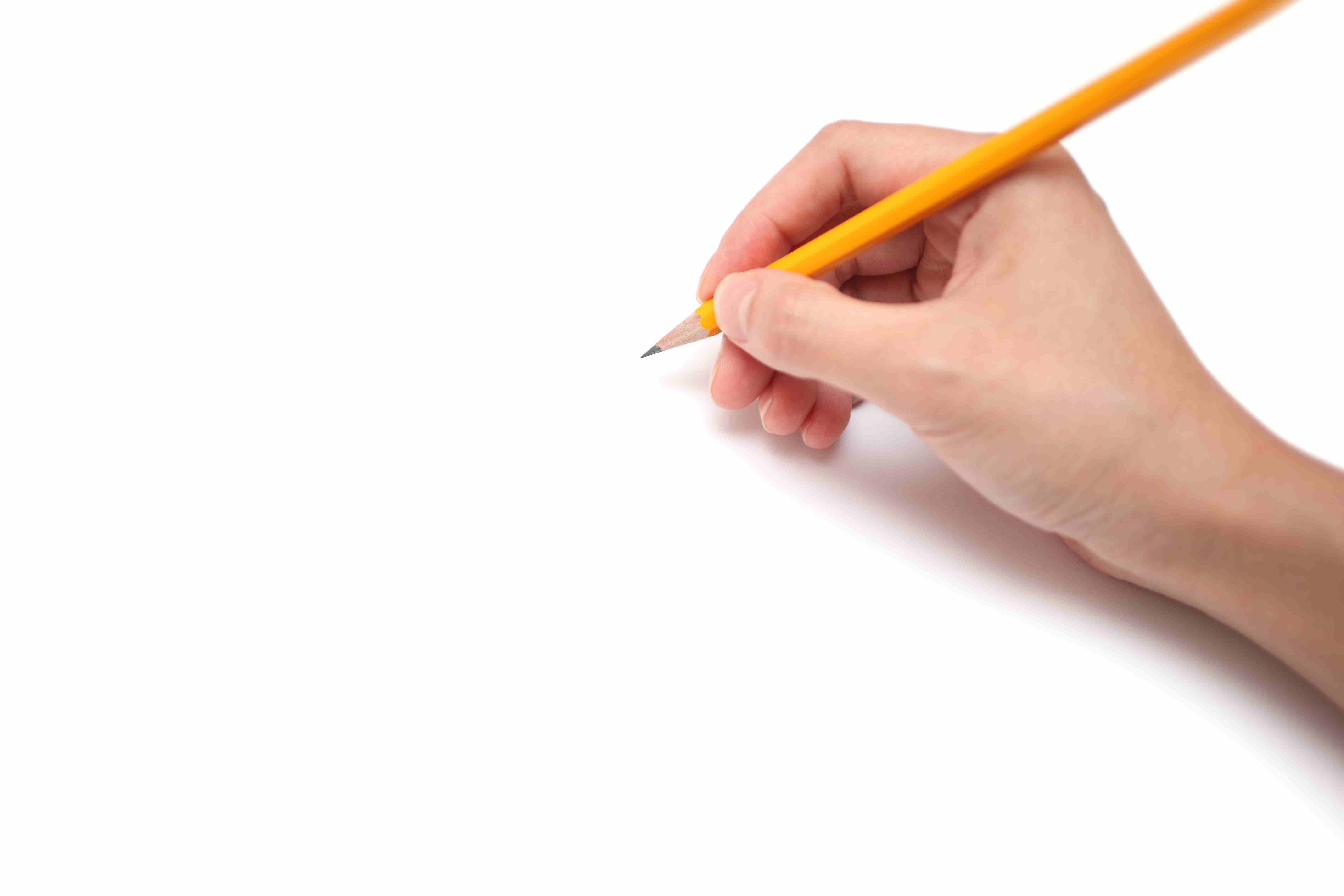 A hand is holding a pencil ready to draw isolated on white background