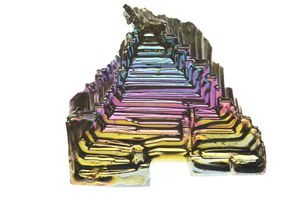 This is pure elemental bismuth, shown in this picture as hopper crystal. It's one of the most beautiful pure elements.