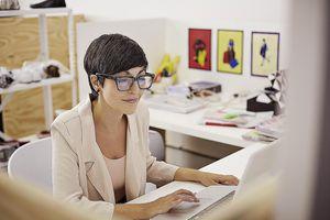 Creative businesswoman typing on laptop