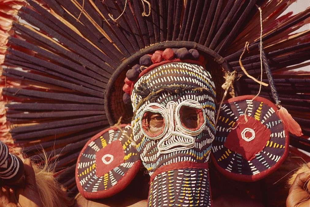 A man wears a Bamileke mask in Cameroon