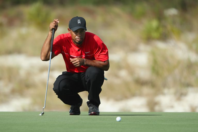 Tiger Woods wearing red shirt during finals