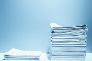 stacks of legal documentation - one short and one tall