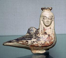 Greek terracotta perfume-bottle in the shape of a siren, circa 570 B.C.