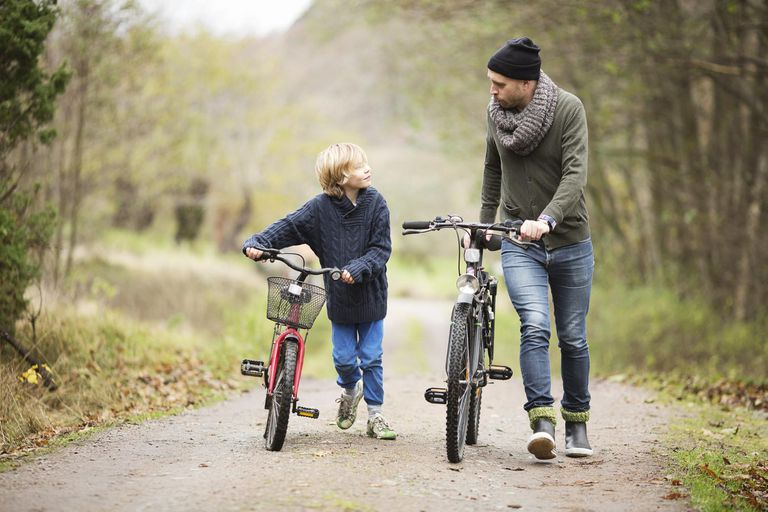 Father and son with bicycles.