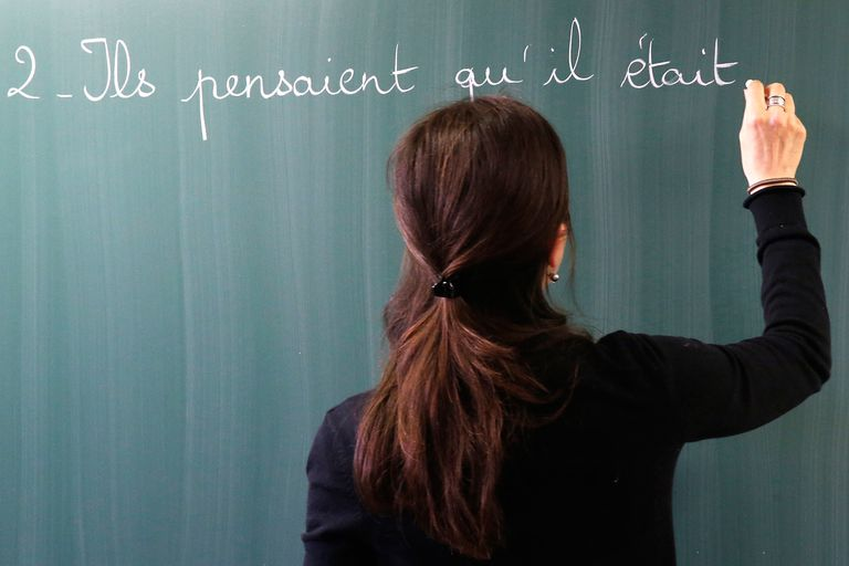 Teacher writing French