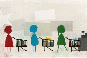 Shoppers standing in line with shopping carts at supermarket