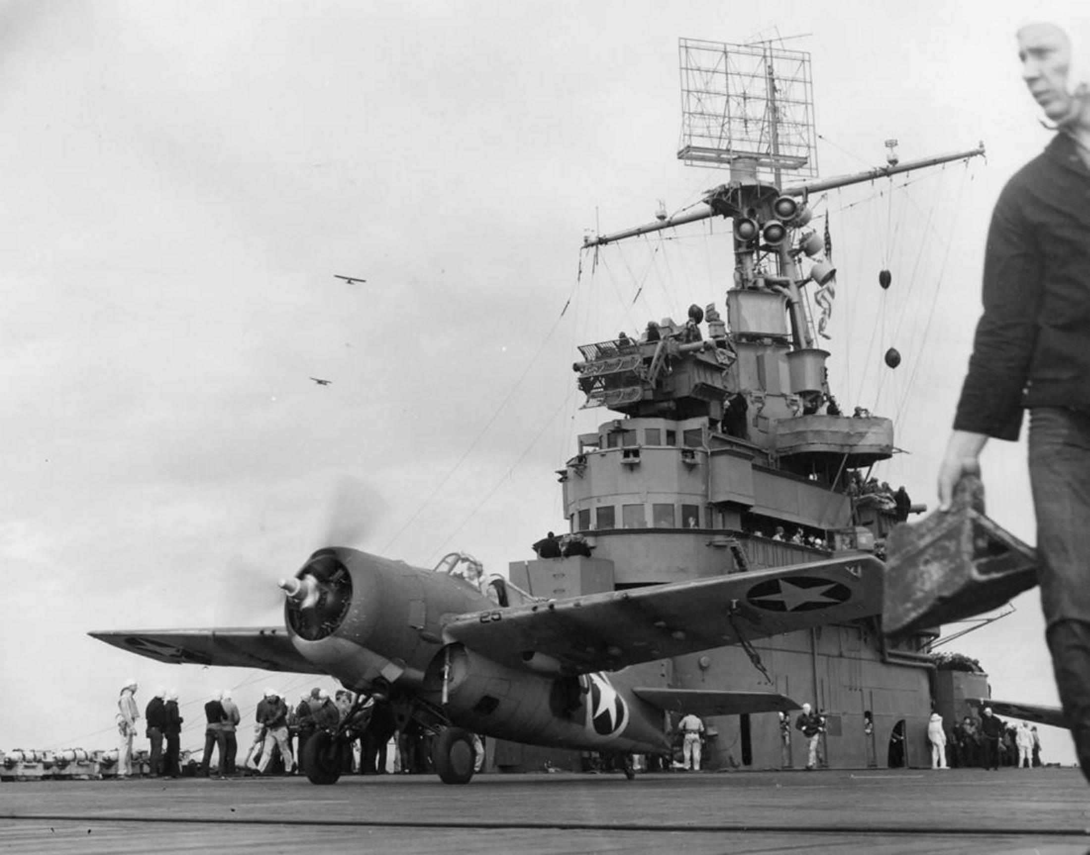 F4F Wildcat fighter taking off from aircraft carrier USS Ranger.