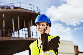 Woman onsite of a large construction project.
