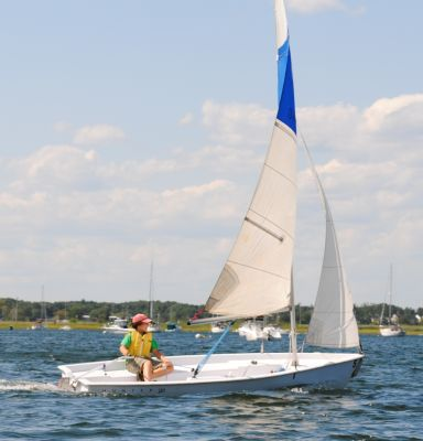 The Hunter 140 with one sailor aboard