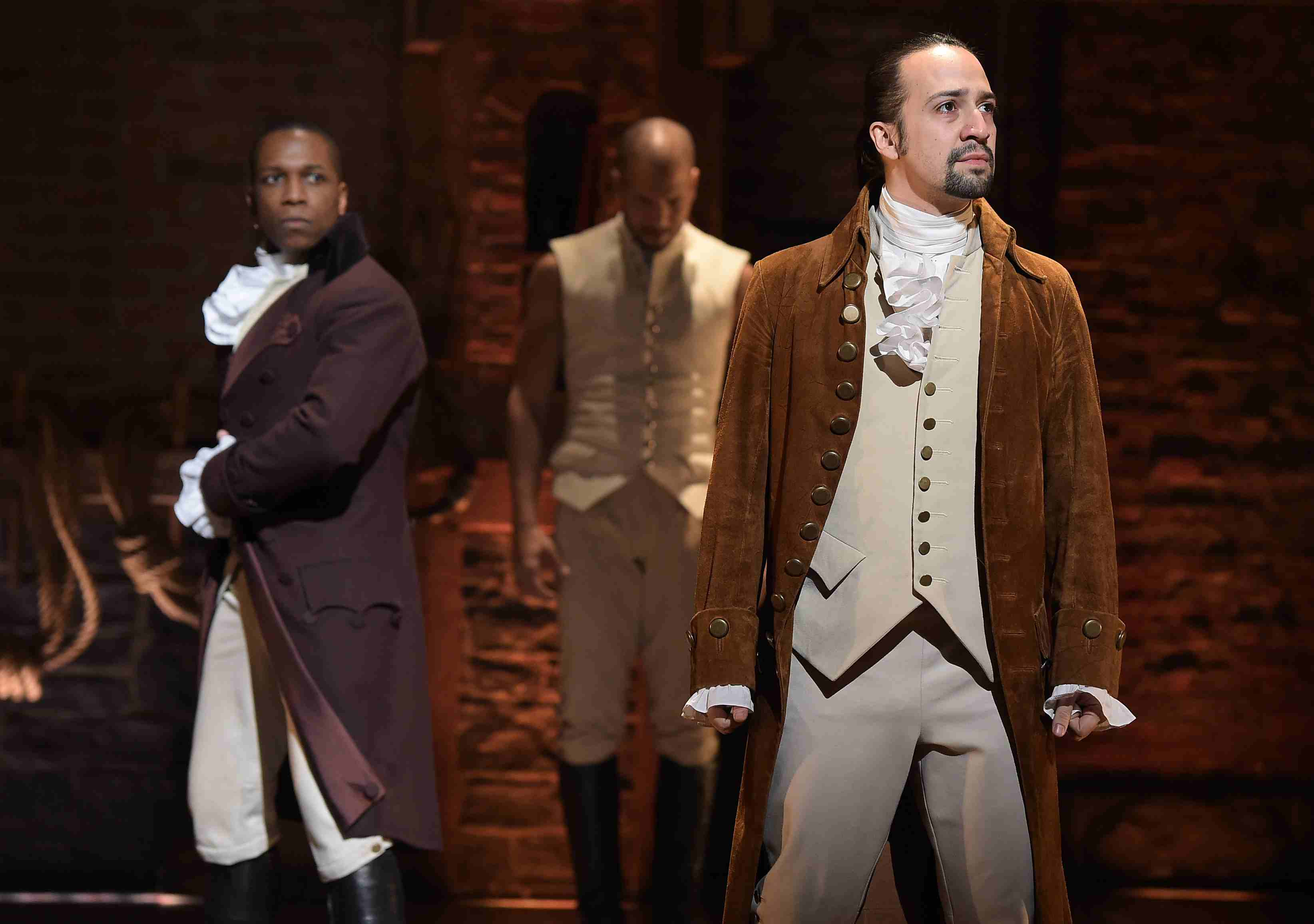 Hamilton actors Leslie Odom, Jr. and Lin Manuel-Miranda perform on stage, representing Ervin Goffman's dramaturgical perspective on social life presented in his book The Presentation of Self in Everyday Life.