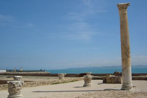 Column at an excavation site on sunny day.