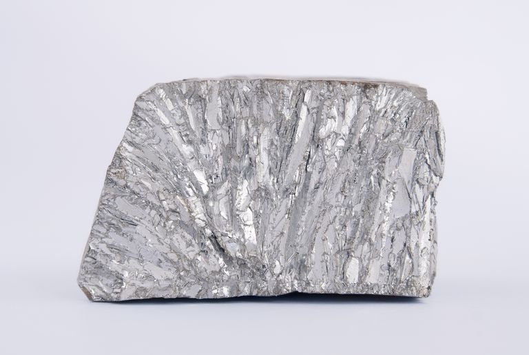 Most metals are lustrous gray solids, like this chunk of zinc. Some nonmetals are colored solids or form liquids and gases at room temperature.
