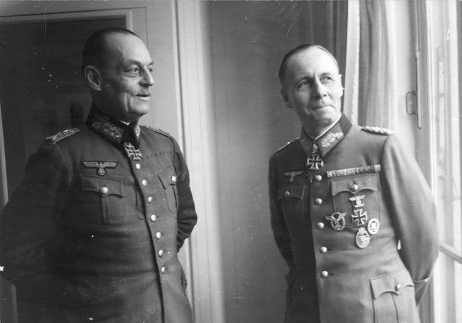 Gerd von Rundstedt and Erwin Rommel in German military uniforms standing near a window.