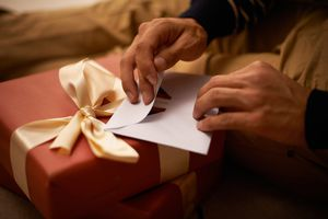 hands opening a gift
