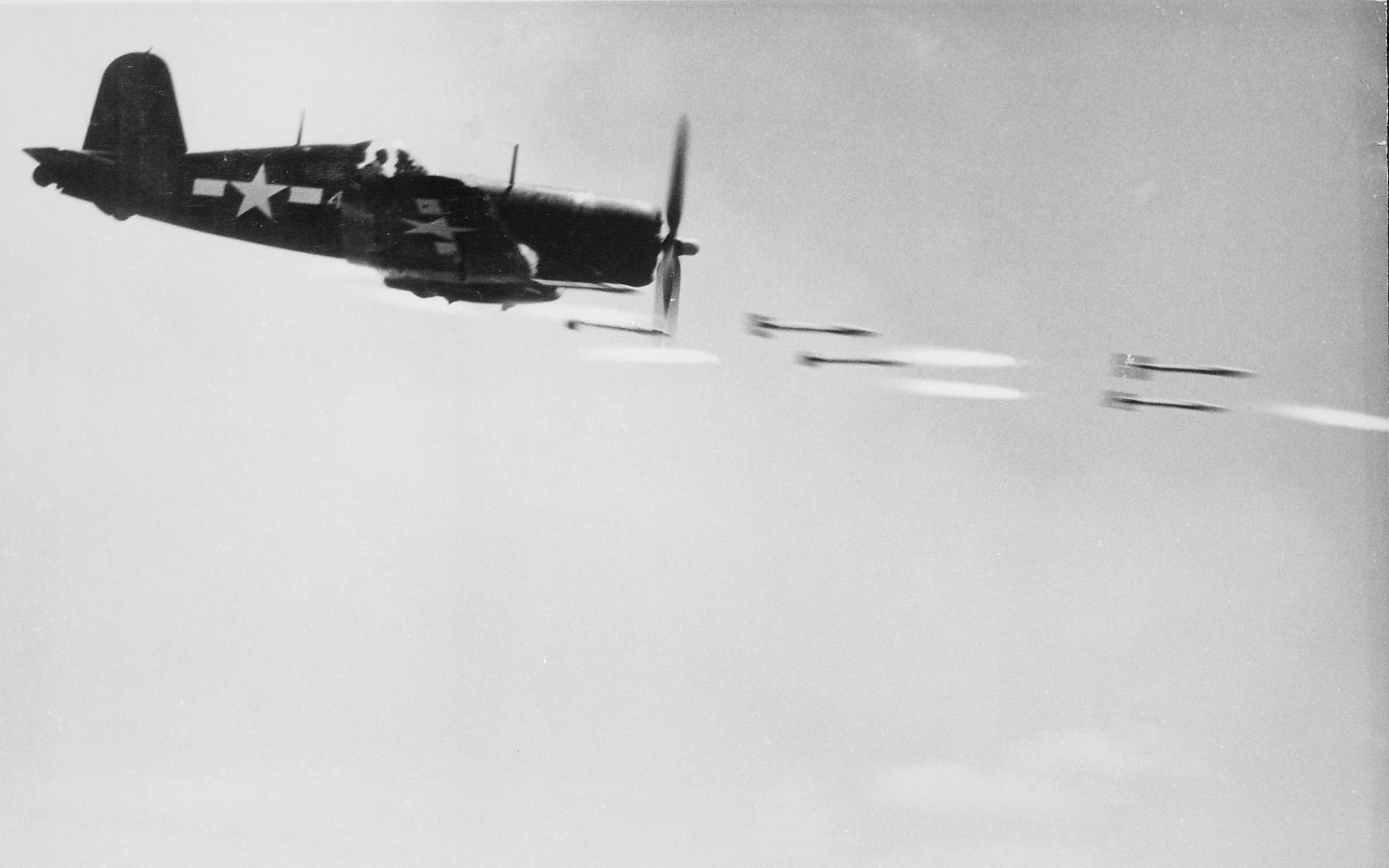 F4U Corsair fighter firing rockets during the Battle of Okinawa.