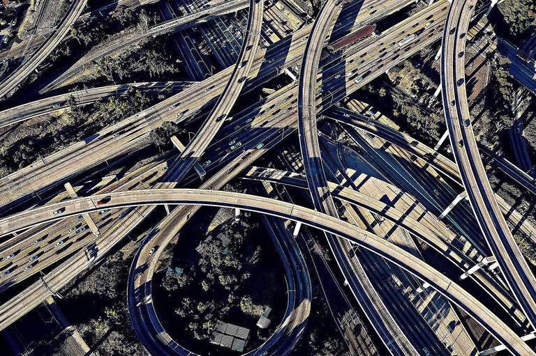 A Flyover View of a Complex Freeway Intersection in Los Angeles Illustrates the Modern City and Lifestyle That Results From the View of Modernization Theory